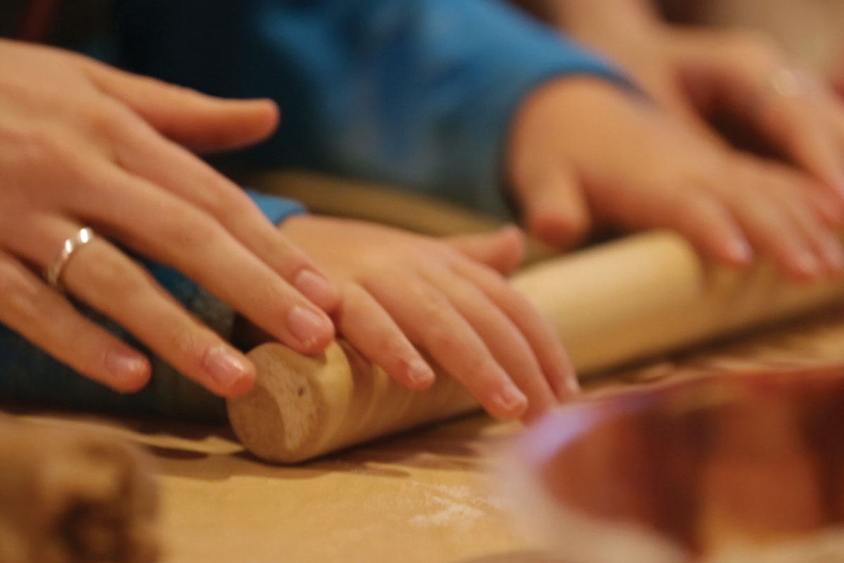 Dough being worked with a rolling pin