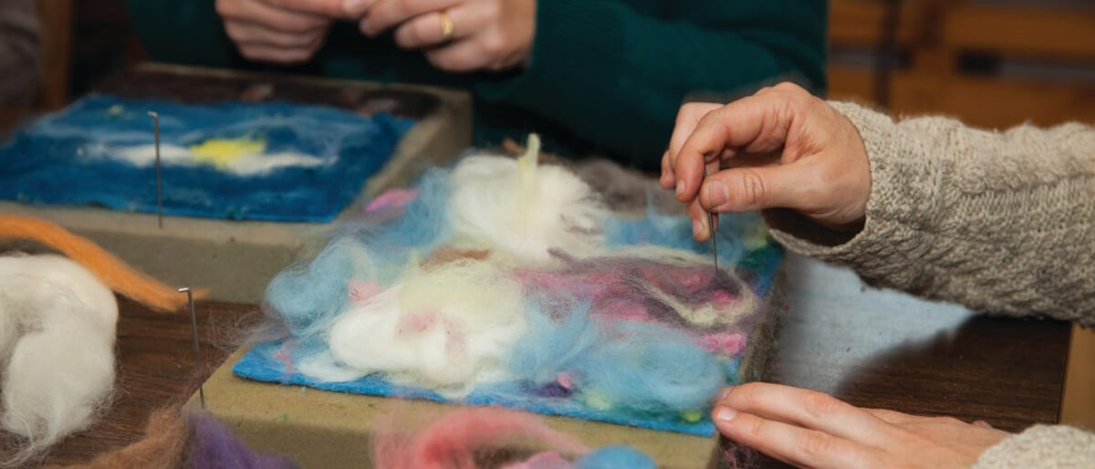 students practicing felting