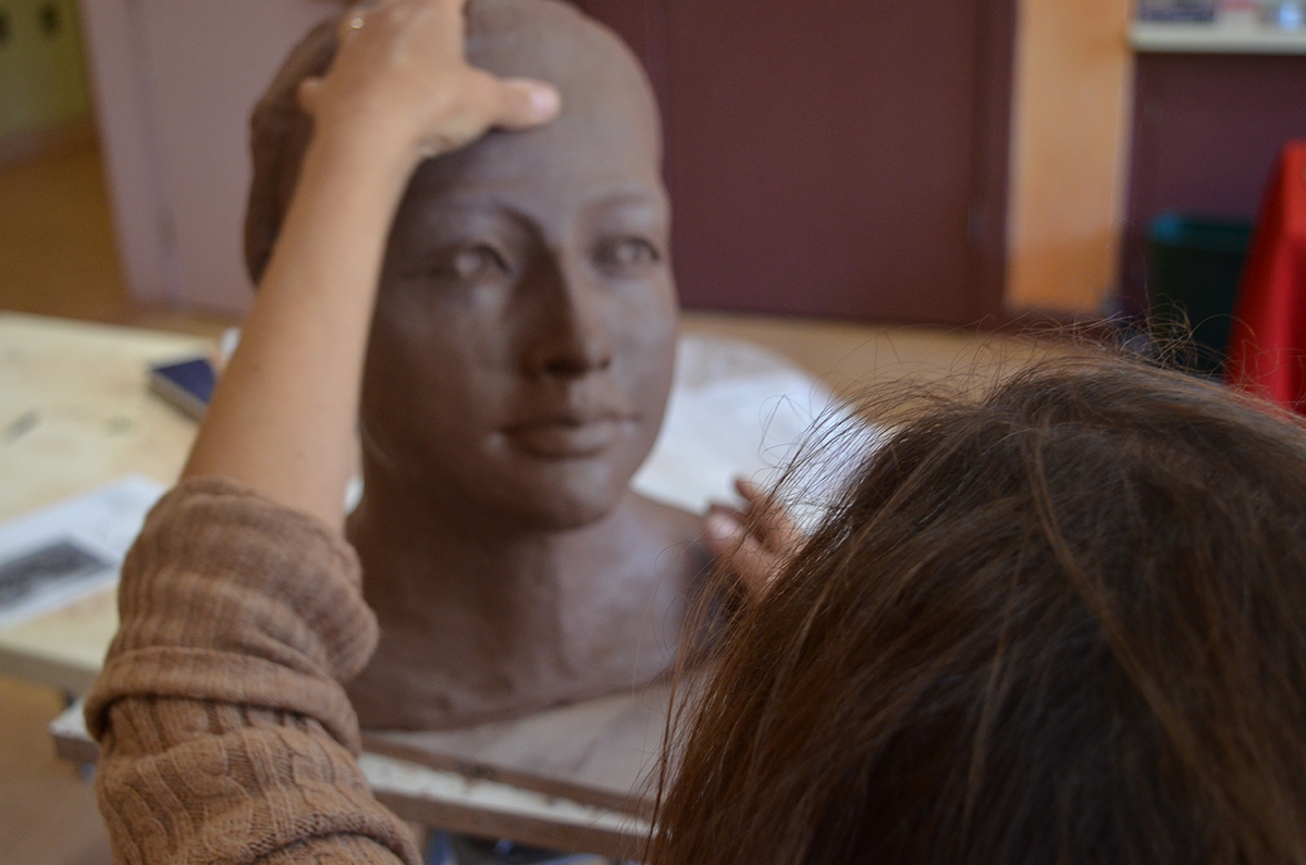 A clay bust being sculpted