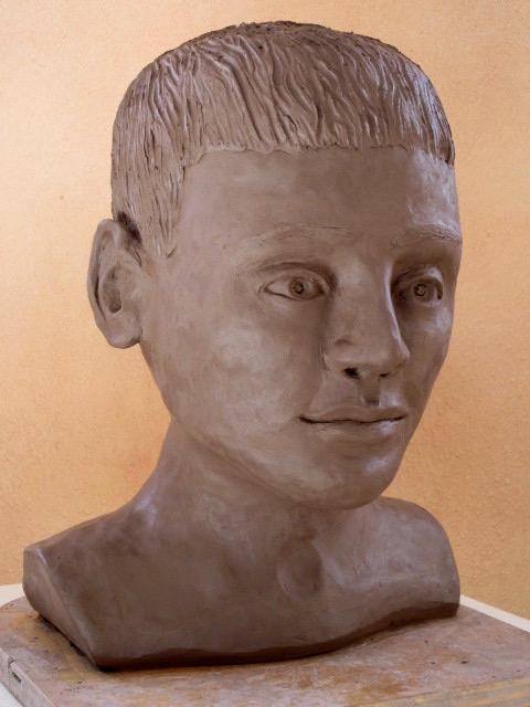 clay bust of a boy
