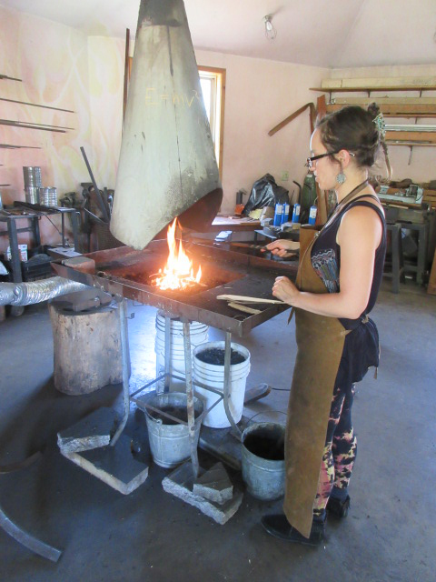 student with an open fire kiln