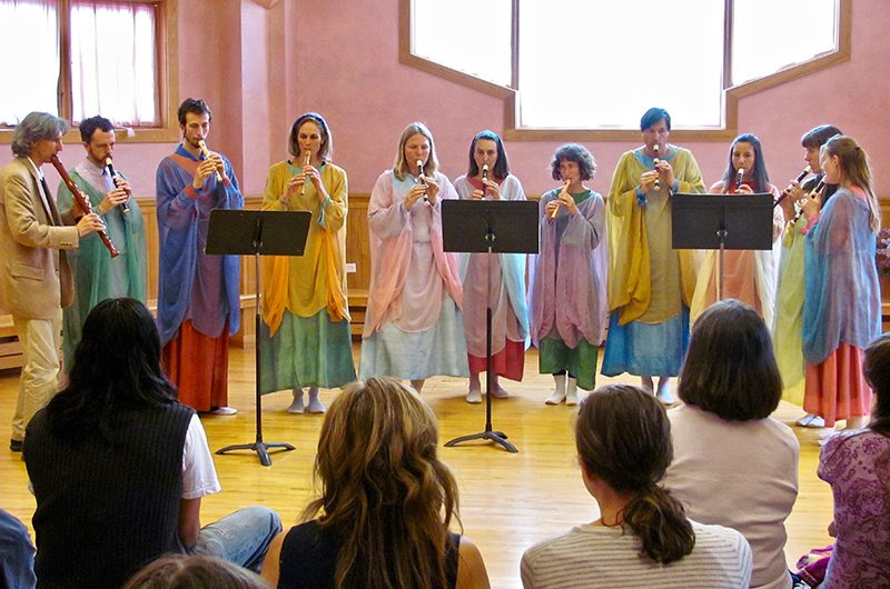 Singers performing in front of an audience