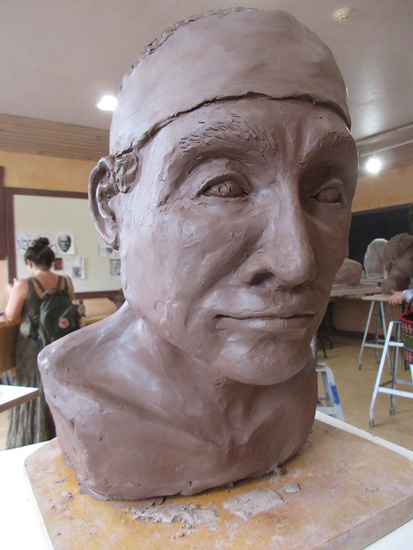 A clay bust before firing
