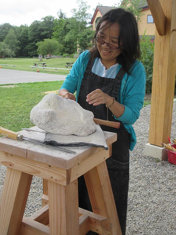 A woman making art outside