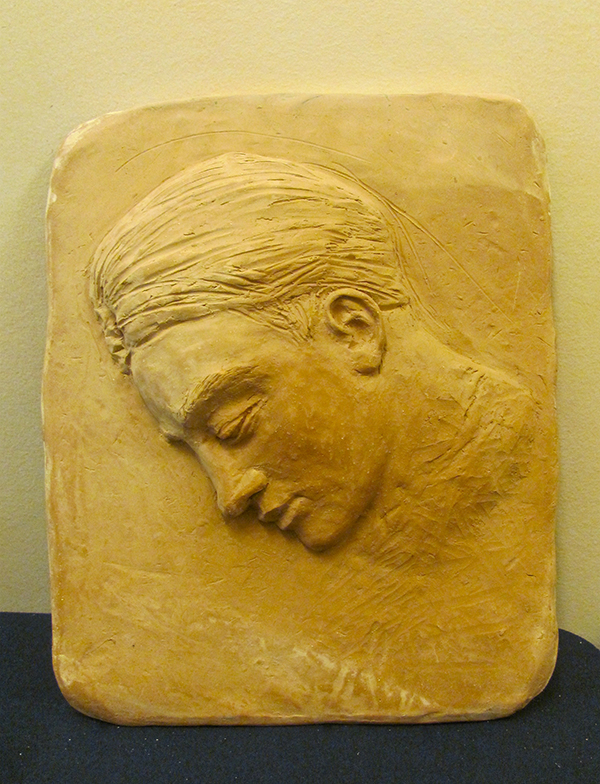 a clay relief of a face