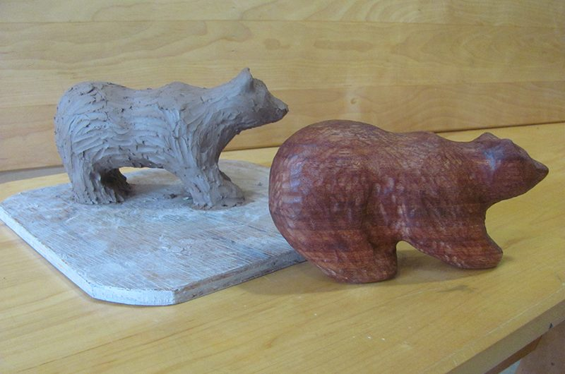Two bear carvings on a table
