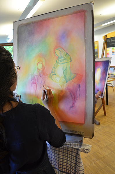 student working on watercolor layer painting