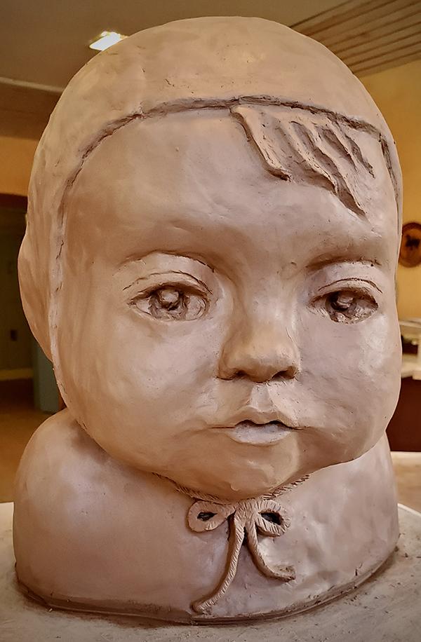 Student clay head sculpture close up